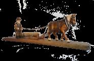 Pferd zieht Baum